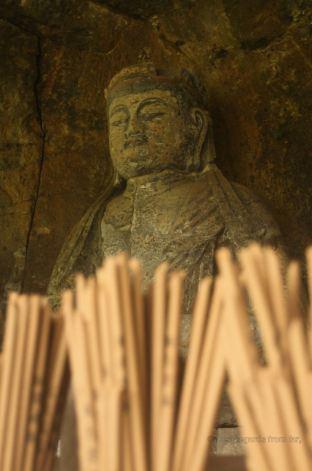 Detail of the Furuzono stone Buddhas: the Dainichi Nyorai (12th century) is considered the finest stone Buddha statue, Usuki, Japan.