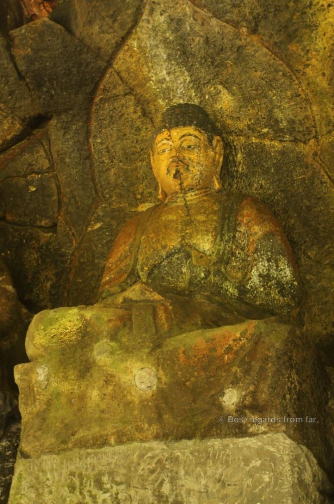 Detail of the 3 Nyorai statues (12th century), Usuki stone Buddhas, Japan.
