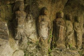 Detail of the 9 Amidas, 12th century sculptures, Usuki stone Buddhas, Japan.