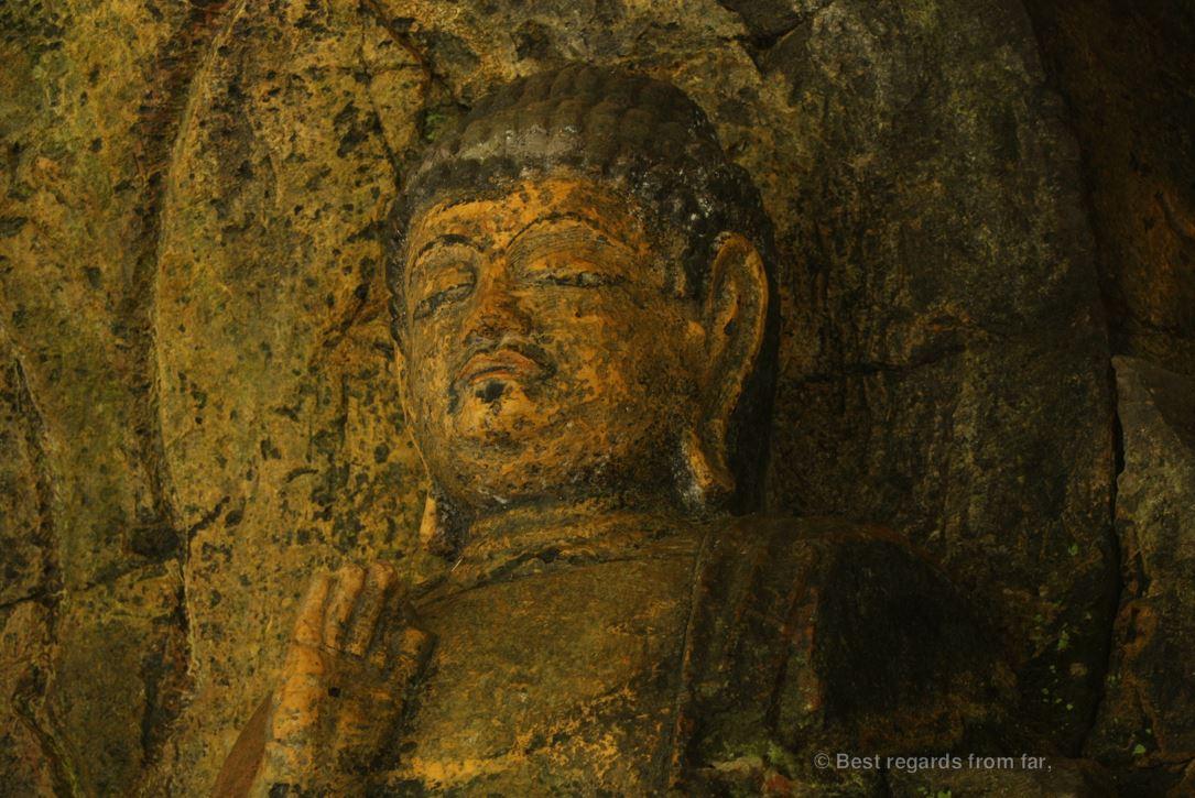 Detail of the 3 Nyorai statues, 12th century, Usuki stone Buddhas, Japan.