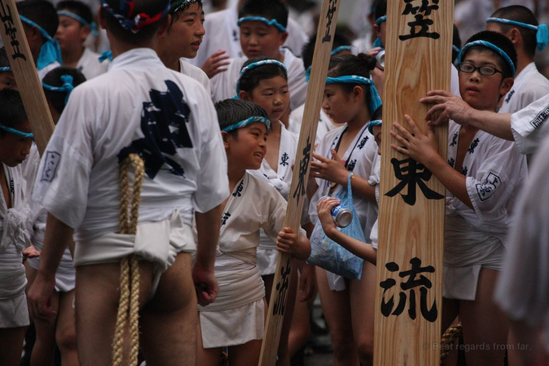 A group of Japanese kids wearing the traditional outfit chats during the Hakata Gion Yamakasa festival in Fukuoka, Kyushu
