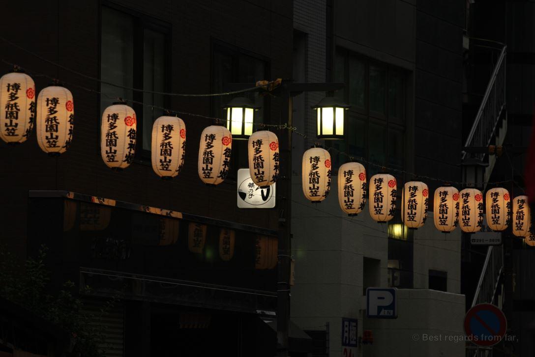 Japanese lanterns lit at dusk and paving the way to the Hakata Gion Yamakasa festival
