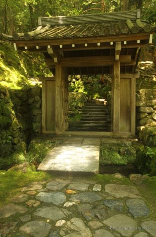 Stone path and Japanese gate leading the the Zen garden in Koke-dera, the temple of moss, Kyoto.