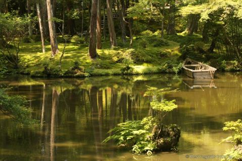 Reflections of an ancient row boat in the pond of Koke-dera, the temple of moss, Kyoto.