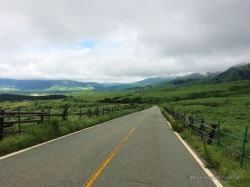 Driving along the grasslands of Mount Aso