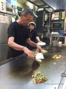 Preparing the okonomiyaki