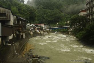 Roaring river through a village