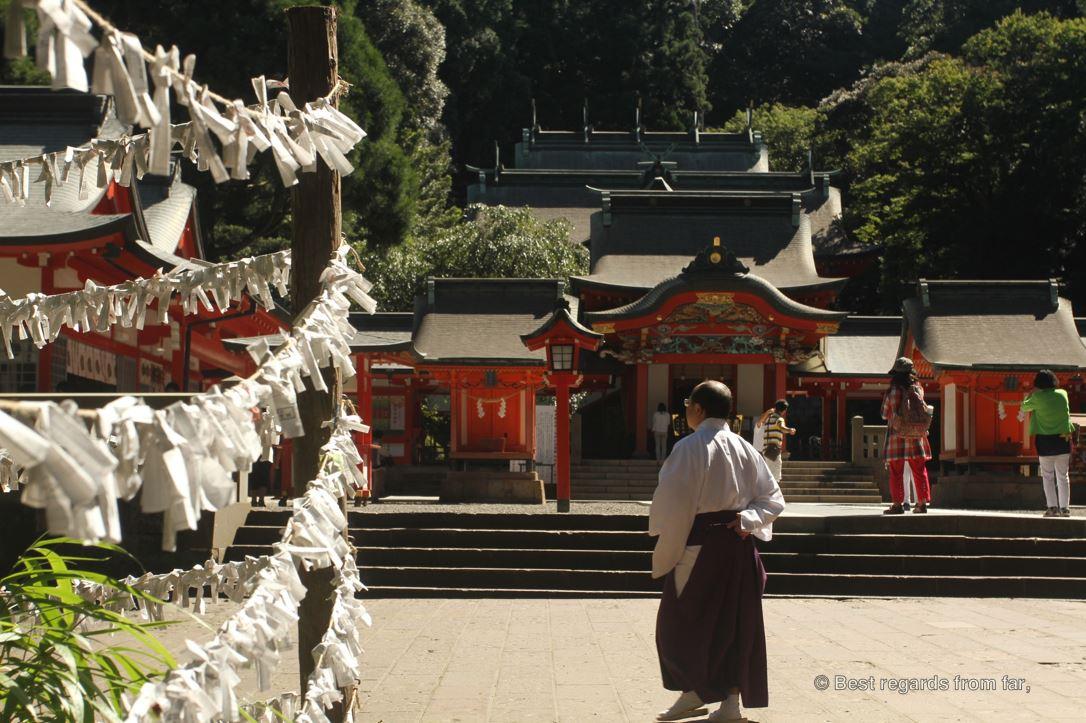 Omikuji hung by a shrine along the road by Ebino Kogen, Japan.