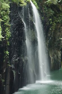 Spectacular waterfall of Takachiho along the volcanic rocks of Mount Aso, Japan.