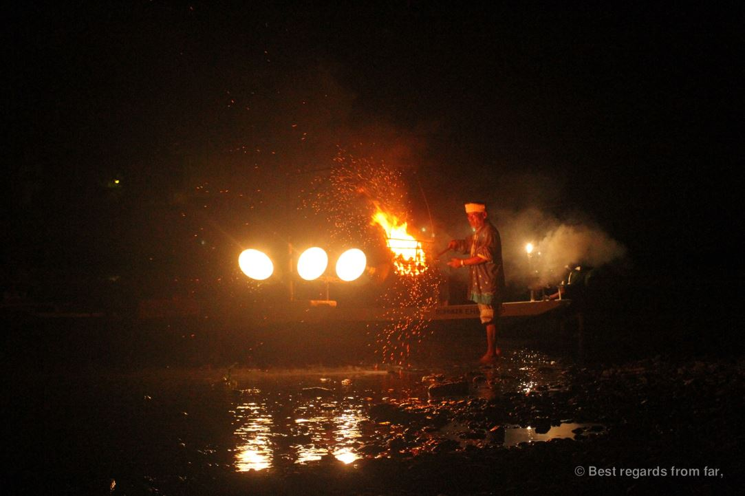 Ancient tradition of cormorants fishing (ukai) in Japan: fisherman by the bonfire by night.