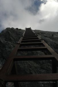 A sturdy and long vertical metal ladder that seems to lead to the sky along the Daikiretto ridgeline hike in the Japanese Alps.
