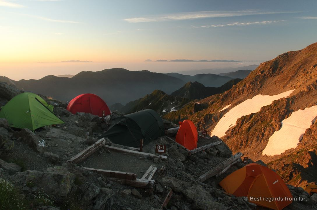 The high-altitude Yari-dake camp with colourful technical tent and our over-sized tunnel tent, while trekking the Japanese Alps.