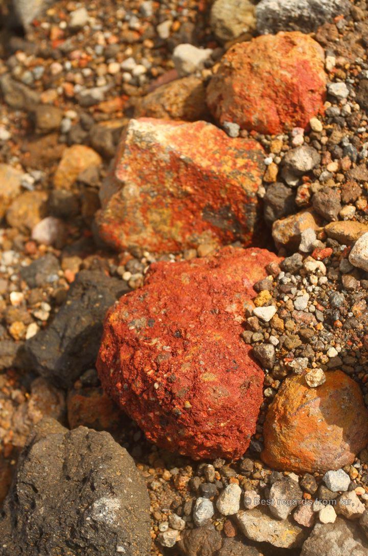 Red volcanic rocks on the active Asahi-dake volcano in the Daisetsuzan National Park, Hokkaido Japan. The start of the Grand Traverse hike.