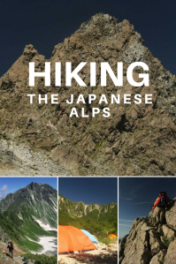 Rocky peak of Mount Asahi-dake with blue skies, a person with backpack hiking a ridgeline, snow and colourful tents in the mountain.