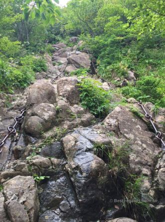 Two metal chains against a steep rocky mountain slope in the Ishizuchi san, Shikoku.