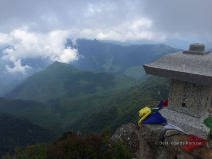 View from the summit of the Ishizuchi san overlooking green mountain tops on a cloudy day.