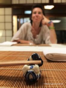 Chopsticks resting on a beautiful piece of Kyoto ceramics.