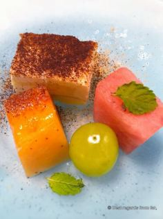 Sesame tiramisu with melon dices.