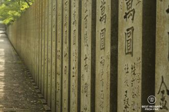 Alley leading to Kompira-san with concrete beams with Japanese characters.
