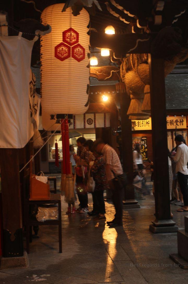 Believers praying in front of the Kushida shrine, Fukuoka.