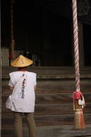 A henro, or pilgrim walking the 88 temples of Shikoku, wearing the the traditional hat and white shirt.