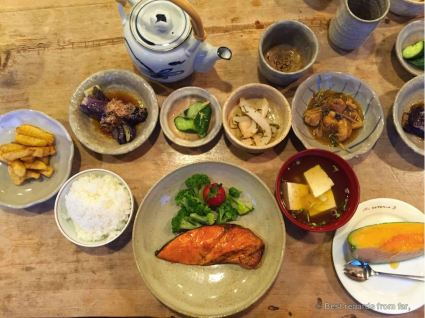 Delicious home-made dinner with potatoes from Hokkaido, grilled eggplants, pickled cucumbers, cuttlefish, miso with tofu, grilled salmon and melon.
