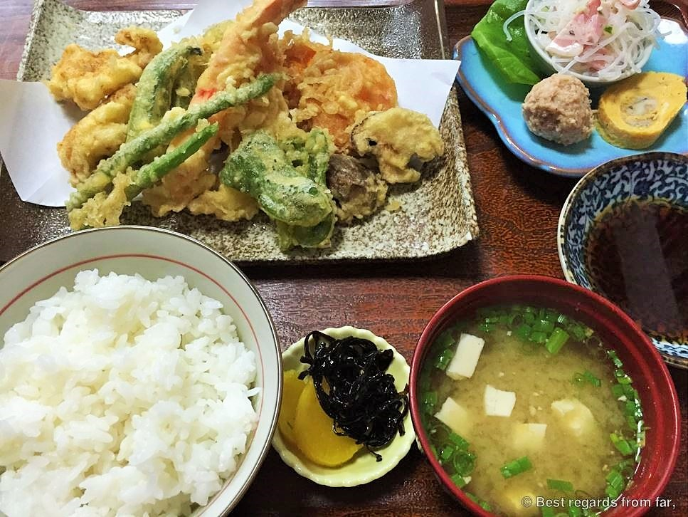 Tempura vegetables with its side dishes including rice and miso soup, Japan.