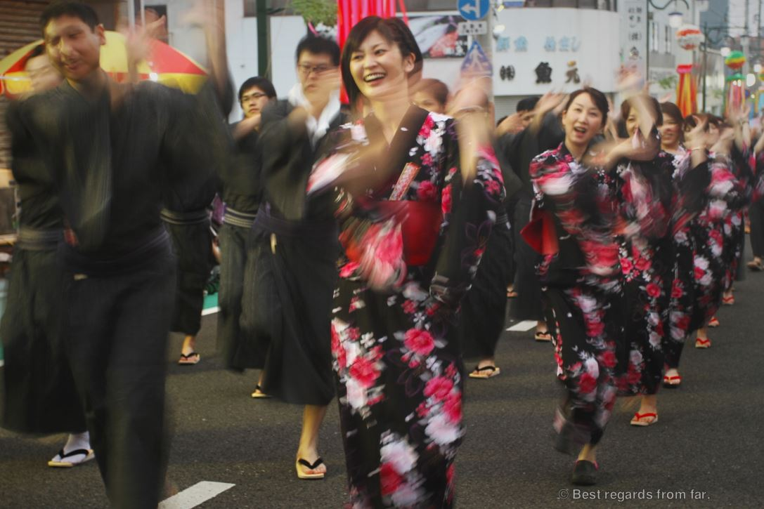 A procession of Japanese women wearing traditional kimonos at the Shikokuchuo summer festival of Shikokuchuo, Japan
