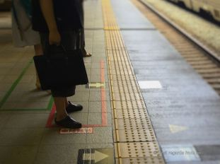 Japanese people waiting for their train