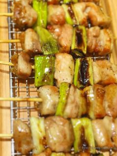 Yakitori of chicken thigh with Japanese leek (negima).