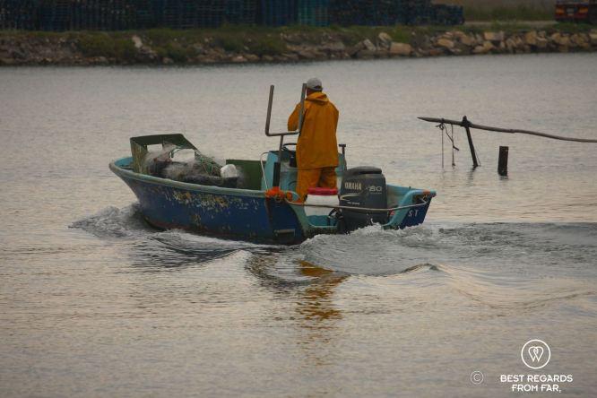 A fisherman setting out on the Thau Lake, Sète, France