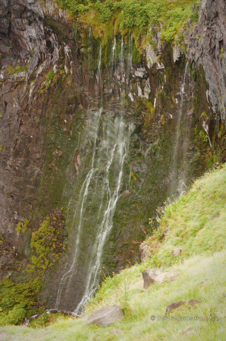 Waterfall along the cliffs of the remote Shiretoko Peninsula, Hokkaido, Japan.