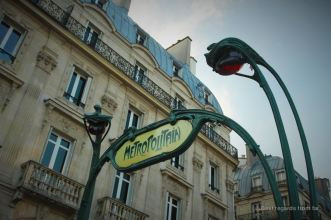Art nouveau subway sign in the heart of Paris