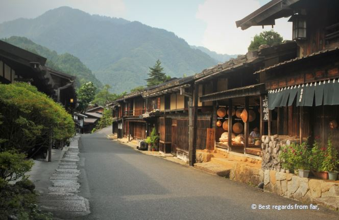 Barren street of Tsumago, mountains and trees.