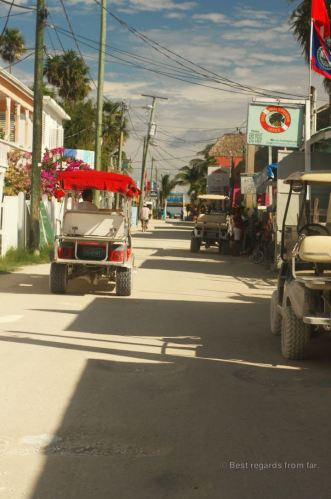 Unpaved streets and local vehicles of Caye Caulker, Belize