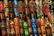 Colourful wooden masks sold by merchants in Chichén Itza, Mexico