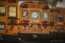 Pimped school buses in their original colours, Guatemala