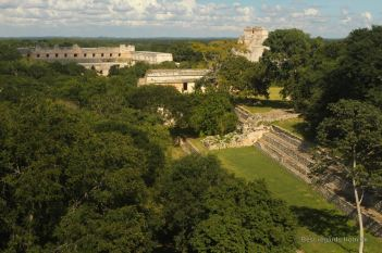The pyramid of the magician and the Quadrangle of the Nuns in the background, Uxmal, Mexico