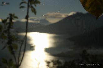 Volcano Fuego framed by a spider web, Lake Atitlan, Guatemala