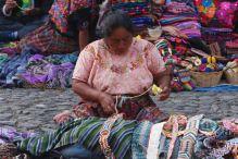 Macrame knotting on the handicraft market of Antigua, Guatemala