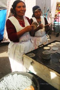 Making tortillas on the market of Totonicapan, Guatemala