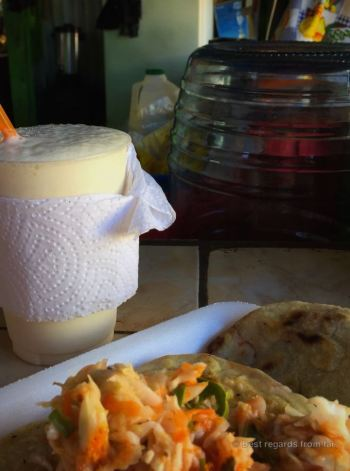 Pupusa covered in curtido with a banana licuado: enjoy!