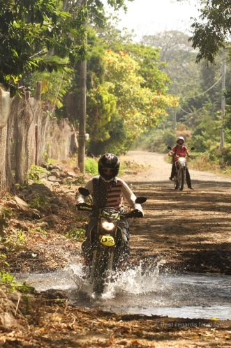 Small river crossing with our motorbikes on Ometepe island, Nicaragua