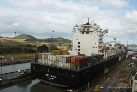 A container ship going through the Miraflores lock, Panama Canal