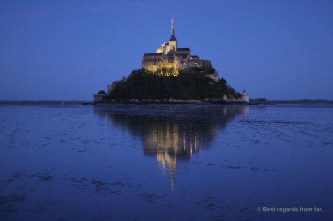 The Mont Saint Michel, reflected in the waters of its bay, France