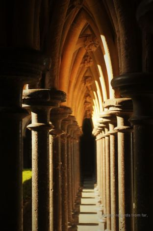 Play of light on the pillars surrounding the cloister, Mont Saint Michel, France