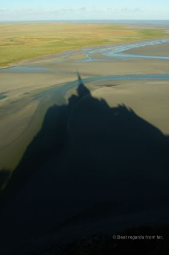 Shadow of the Mont Saint Michel casted on its magnificent bay, France