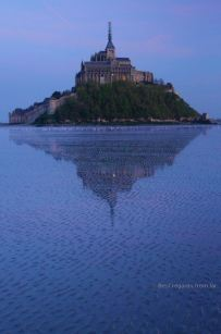 Mont Saint Michel and its reflection at dusk, France