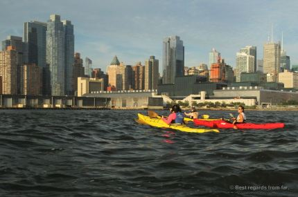 Kayaking the Hudson, with the Manhattan skyine to out right, New York City