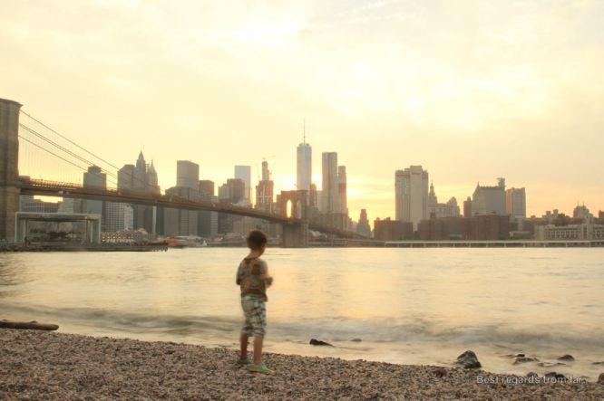 Boy versus city, the Manhattan Skyline from DUMBO, Brooklyn, New York City